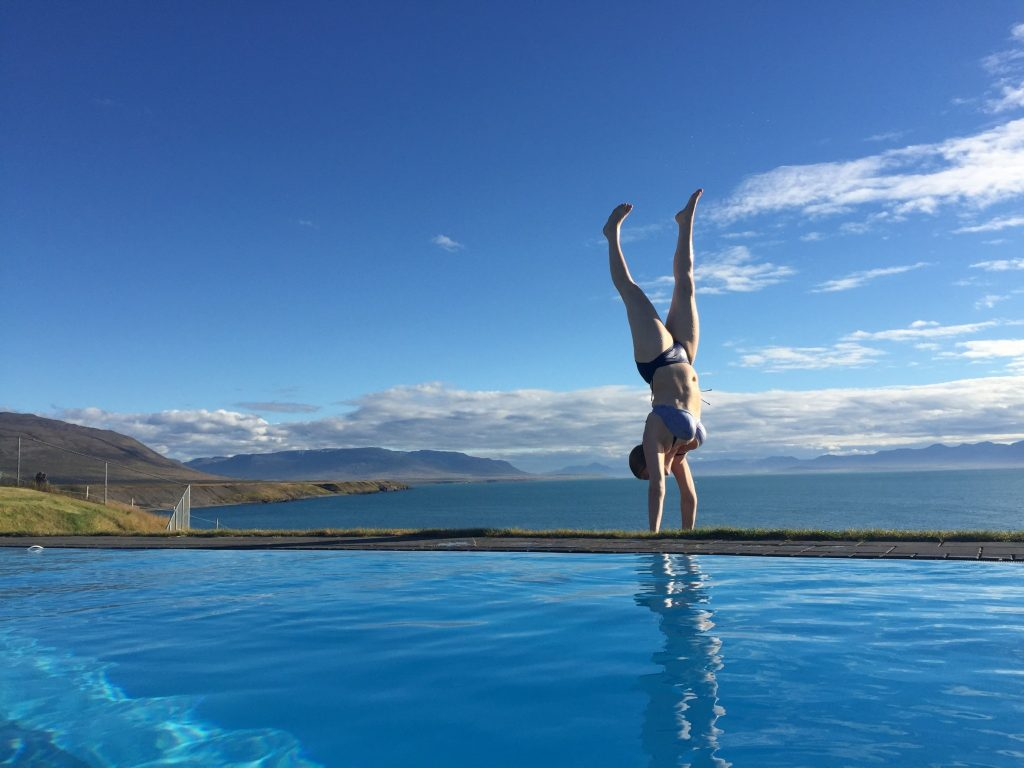 By the most beautiful swimming pool in Iceland. Handstand - My Yoga Anxiety