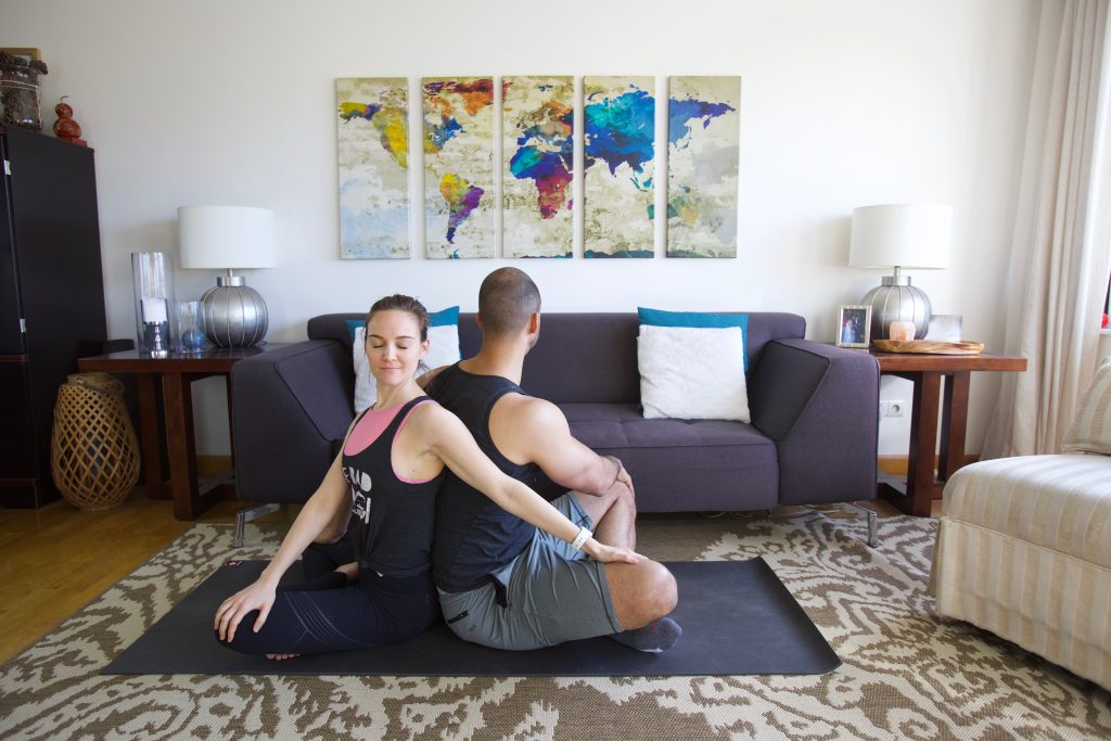bad yogi partner yoga seated twist